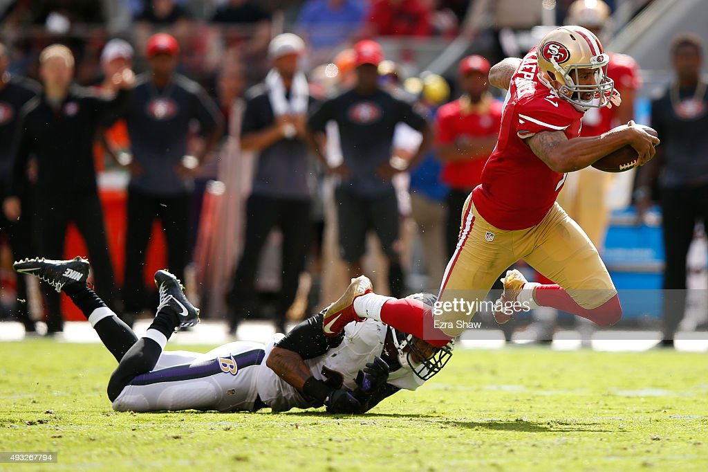 Quarterback Colin Kaepernick #7 of the San Francisco 49ers is tackled by cornerback Jimmy Smith #22 of the Baltimore Ravens during their NFL game at Levi's Stadium on October 18, 2015 in Santa Clara, California.