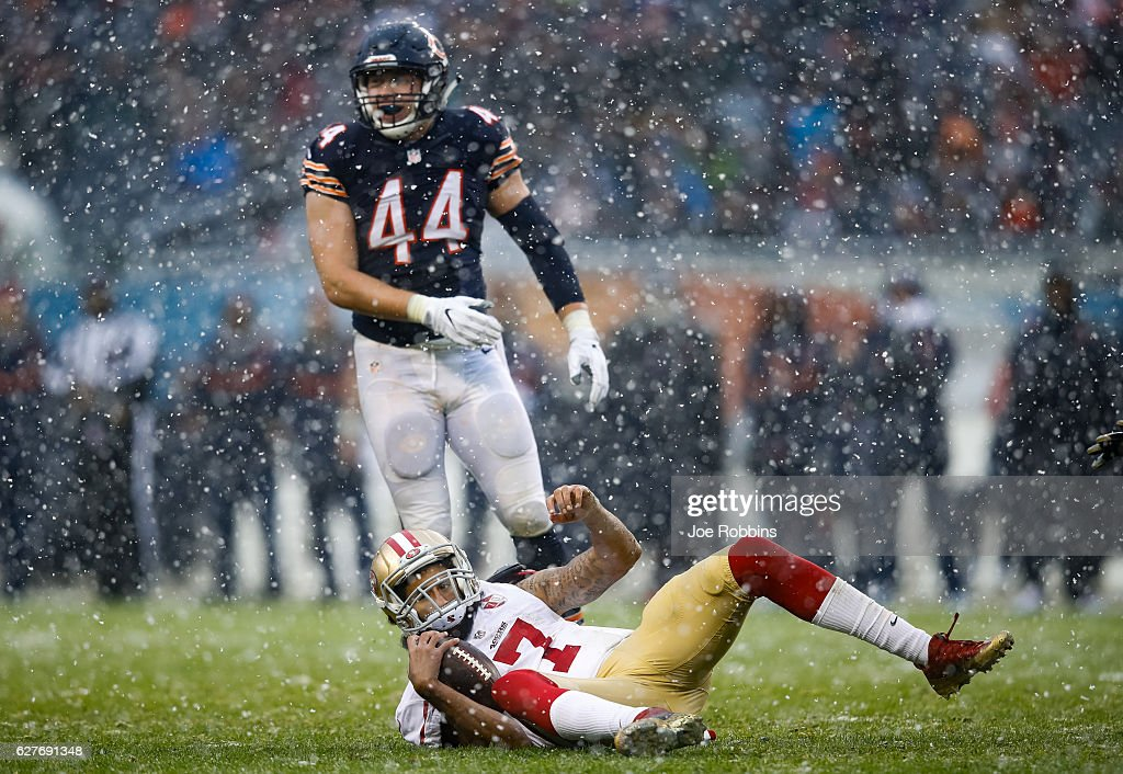 Quarterback Colin Kaepernick #7 of the San Francisco 49ers lays in front of Nick Kwiatkoski #44 of the Chicago Bears in the third quarter at Soldier Field on December 4, 2016 in Chicago, Illinois.