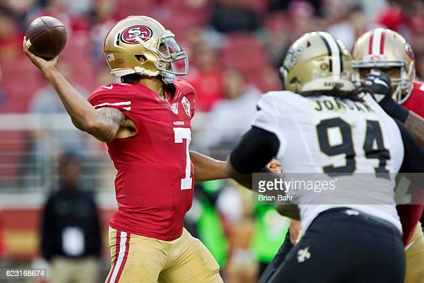 Quarterback Colin Kaepernick of the San Francisco 49ers makes a 19yard throw under pressure from defensive end Cameron Jordan of the New Orleans...