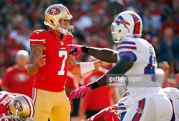 Quarterback Colin Kaepernick of the San Francisco 49ers reads the defense against linebacker Bryan Scott and the Buffalo Bills on October 7 2012 at...
