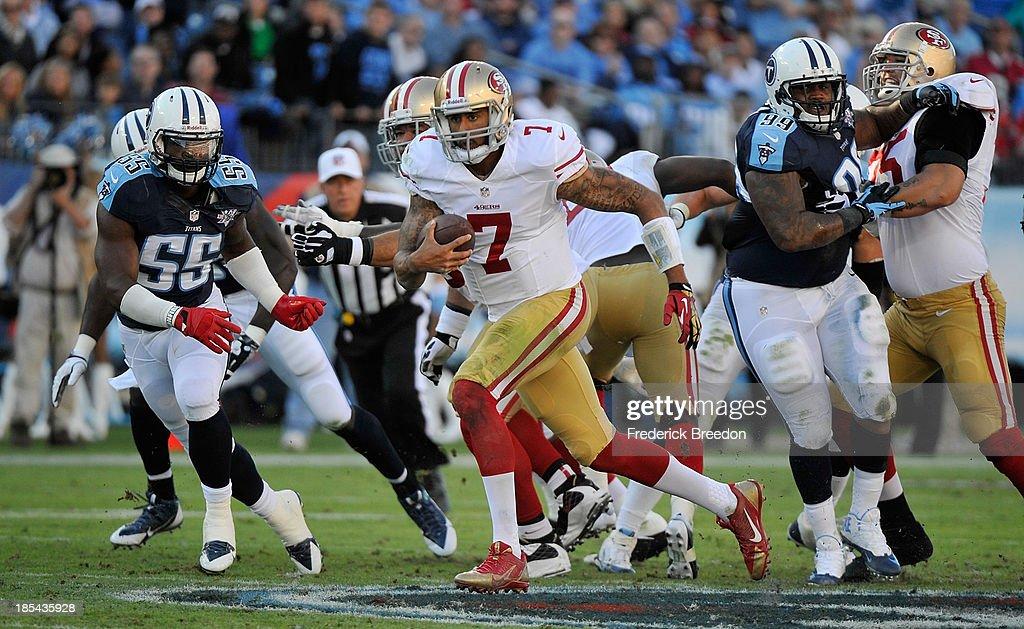 86e27a099c3 Quarterback Colin Kaepernick of the San Francisco 49ers rushes ...