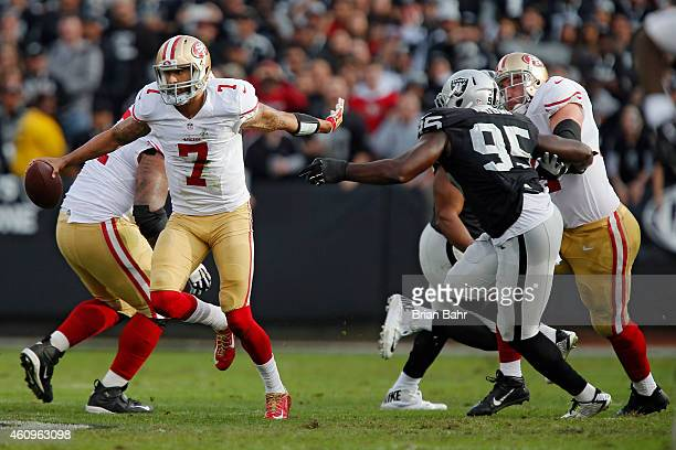 Quarterback Colin Kaepernick of the San Francisco 49ers scrambles for 16-yards against defensive end Benson Mayowa of the Oakland Raiders late in the...
