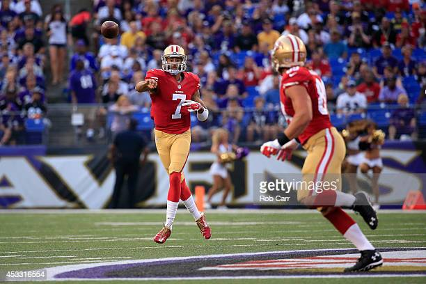 Quarterback Colin Kaepernick of the San Francisco 49ers throws a pass to tight end Vance McDonald against the Baltimore Ravens during the first half...