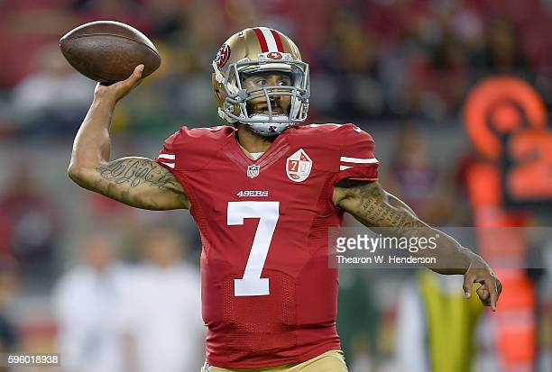 Quarterback Colin Kaepernick of the San Francisco 49ers throws a pass against the Green Bay Packers in the first half of their preseason football...