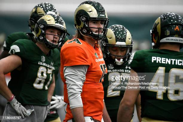 CSU quarterback Collin Hill #15 and his teammates get ready to huddle during the team's 2019 Rams football spring game at the CSU's indoor practice...