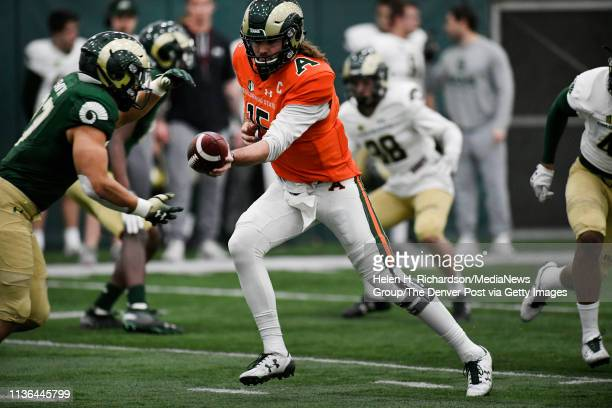 CSU quarterback Collin Hill #15 right passes the ball to running back Jaylen Thomas #27 left during the team's 2019 Rams football spring game at the...