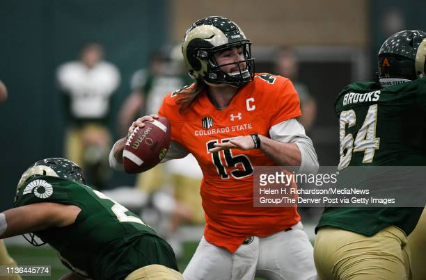 CSU quarterback Collin Hill #15 winds up to make a pass during the team's 2019 Rams football spring game at the CSU's indoor practice facility March...