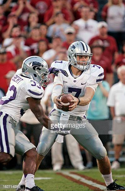 Quarterback Collin Klein and running back John Hubert of the Kansas State Wildcats perform a fake hand off against the Oklahoma Sooners on September...