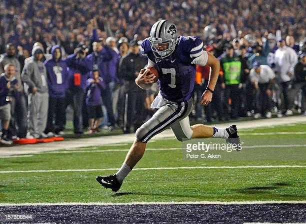Quarterback Collin Klein of the Kansas State Wildcats scores a touchdown against the Texas Longhorns during the second half on December 1 2012 at...
