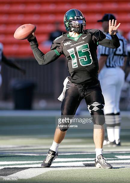 Quarterback Colt Brennan of the University of Hawaii Warriors practices on the field before the start of their game against the Charleston Southern...