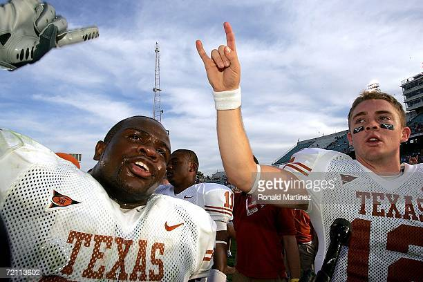 Quarterback Colt McCoy and Rashad Bobino of the Texas Longhorns celebrate a 2810 win against the Oklahoma Sooners during the Red River Shootout at...