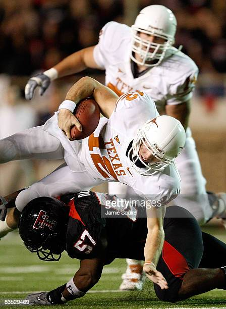 Quarterback Colt McCoy of the Texas Longhorns carries the ball as he is upended by Brian Duncan of the Texas Tech Red Raiders on November 1, 2008 at...