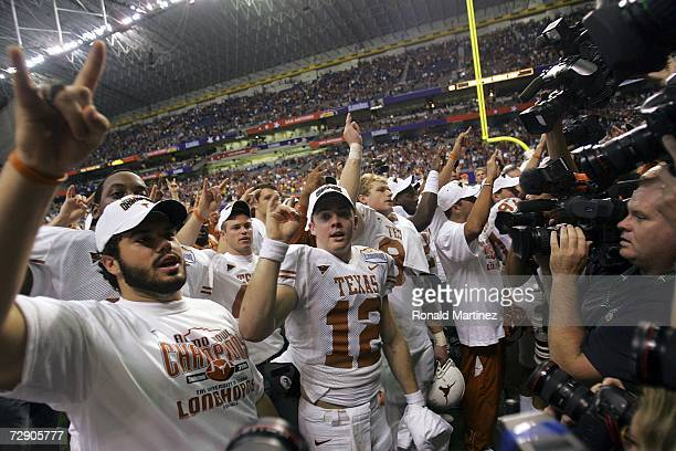 Quarterback Colt McCoy of the Texas Longhorns celebrates a 2624 win against the Iowa Hawkeyes in the Alamo Bowl on December 30 2006 at the Alamodome...