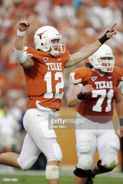 Quarterback Colt McCoy of the Texas Longhorns celebrates a touchdown against the Rice Owls in the first quarter on September 22 2007 at Darrell K...