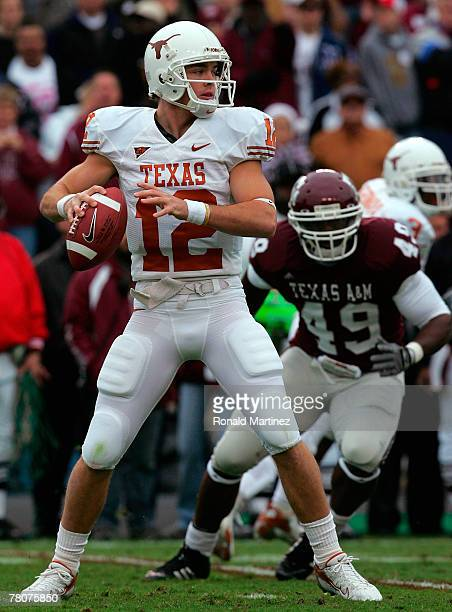 Quarterback Colt McCoy of the Texas Longhorns drops back to pass against the Texas A&M Aggies in the first quarter at Kyle Field on November 23, 2007...