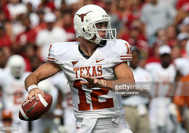 Quarterback Colt McCoy of the Texas Longhorns drops back to pass against the Oklahoma Sooners during the Red River Rivalry at the Cotton Bowl on...