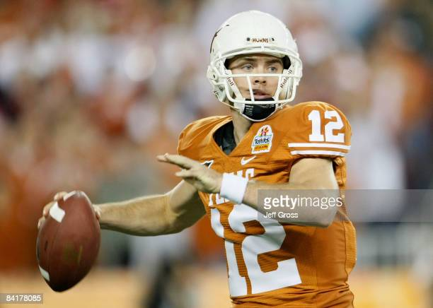 Quarterback Colt McCoy of the Texas Longhorns drops back to pass during the Tostitos Fiesta Bowl Game against the Ohio State Buckeyes on January 5,...