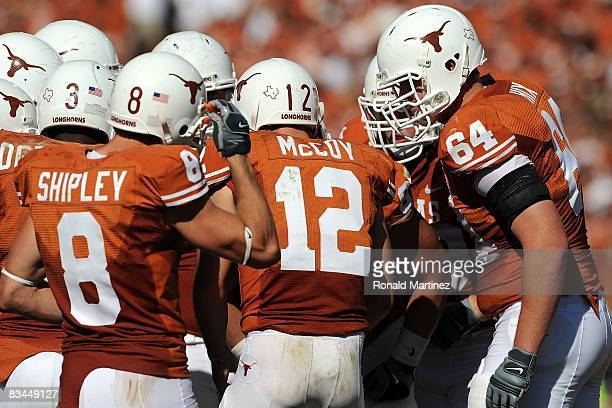 Quarterback Colt McCoy of the Texas Longhorns huddles the offense during play against the Oklahoma State Cowboys at Texas Memorial Stadium on October...