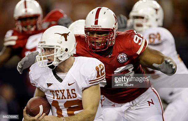 Quarterback Colt McCoy of the Texas Longhorns is sacked by Ndamukong Suh of the Nebraska Cornhuskers in the first quarter of the game at Cowboys...