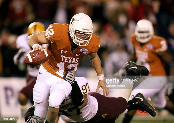 Quarterback Colt McCoy of the Texas Longhorns is sacked for a loss by Luis Vasquez of the Arizona State Sun Devils during the 2nd half of the Pacific...