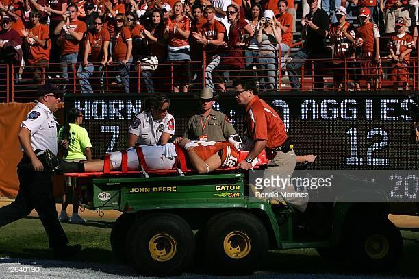 Quarterback Colt McCoy of the Texas Longhorns is taken off the field after an injury during play against the Texas AM Aggies at Darrell K RoyalTexas...