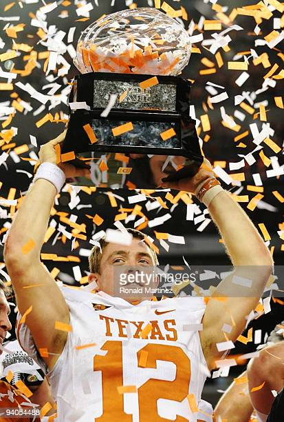 Quarterback Colt McCoy of the Texas Longhorns lifts the trophy after his teams 106 victory over the Nebraska Cornhuskers in the game at Cowboys...
