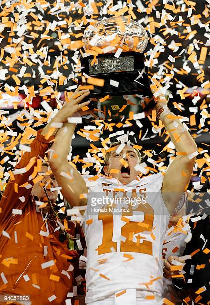 Quarterback Colt McCoy of the Texas Longhorns lifts the trophy with head coach Mack Brown after their teams 106 victory over the Nebraska Cornhuskers...