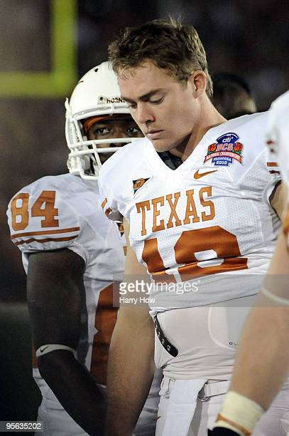 Quarterback Colt McCoy of the Texas Longhorns looks down on the sideline in the third quarter against the Alabama Crimson Tide in the Citi BCS...