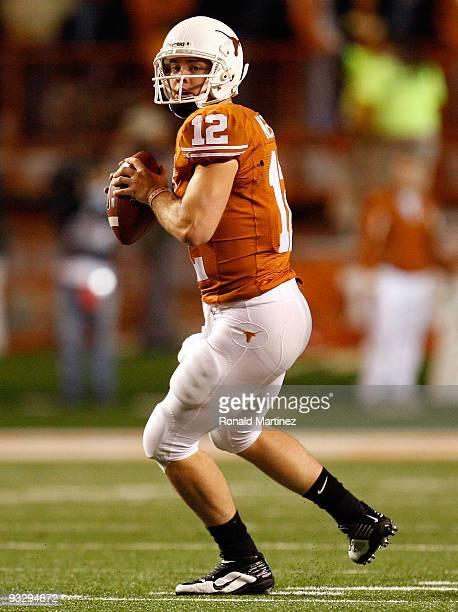 Quarterback Colt McCoy of the Texas Longhorns looks to pass against the Kansas Jayhawks at Darrell K Royal-Texas Memorial Stadium on November 21,...
