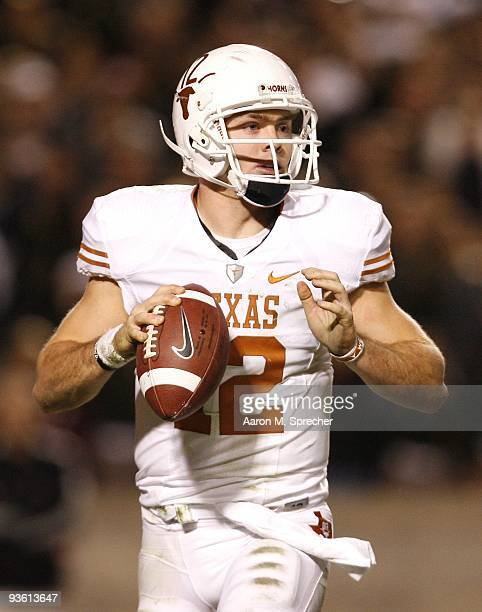 Quarterback Colt McCoy of the Texas Longhorns looks to pass the ball downfield against the Texas AM Aggies in the second half at Kyle Field on...