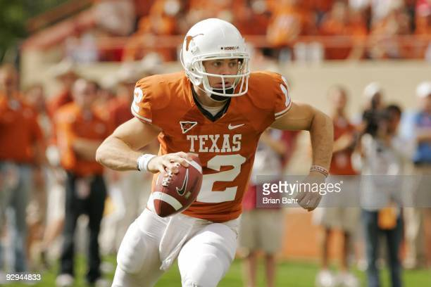Quarterback Colt McCoy of the Texas Longhorns rolls out against the UCF Knights on November 7, 2009 at Darrell K Royal - Texas Memorial Stadium in...