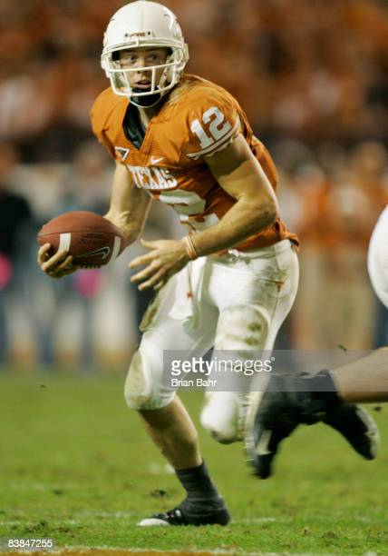 Quarterback Colt McCoy of the Texas Longhorns runs the ball before pulling up to throw against the Texas AM Aggies late in the second quarter at...