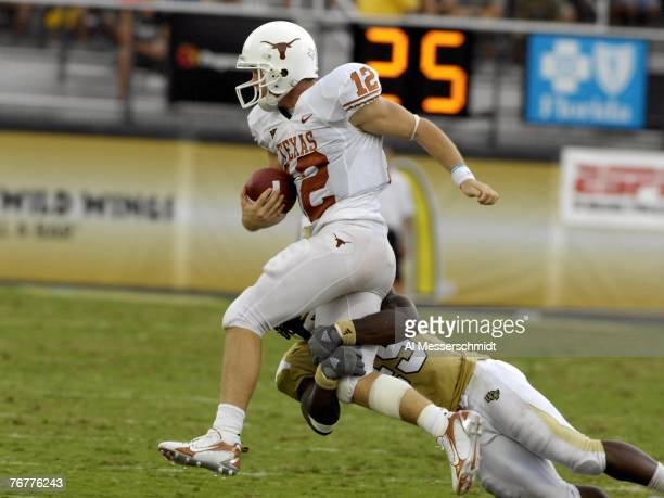 Quarterback Colt McCoy of the Texas Longhorns rushes from the pocket against the University of Central Florida Knights at Bright House Networks...