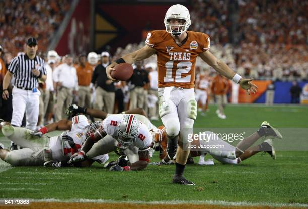 Quarterback Colt McCoy of the Texas Longhorns scores on a 14 yard touchdown rush against the Ohio State Buckeyes during the third quarter of the...