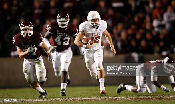 Quarterback Colt McCoy of the Texas Longhorns scrambles away from the Texas AM Aggies defense to score a touchdown in the first half at Kyle Field on...