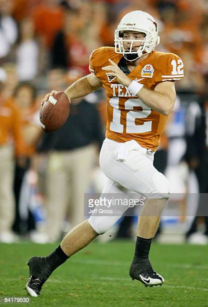 Quarterback Colt McCoy of the Texas Longhorns scrambles with the ball against the Ohio State Buckeyes during the Tostitos Fiesta Bowl Game on January...