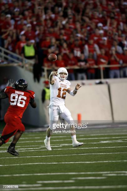 Quarterback Colt McCoy of the University of Texas at Austin Longhorns passes the ball while being pressured by defensive end Keyunta Dawson of the...