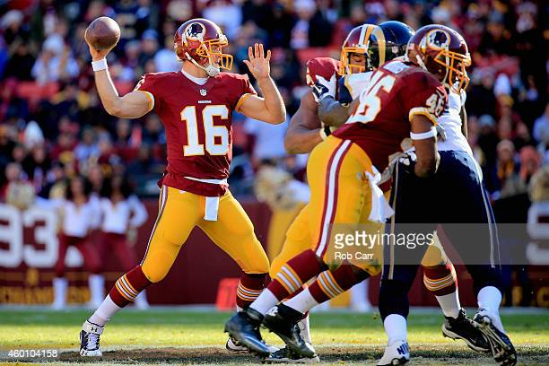 Quarterback Colt McCoy of the Washington Redskins drops back to pass in the first quarter of a game against the St. Louis Rams at FedExField on...
