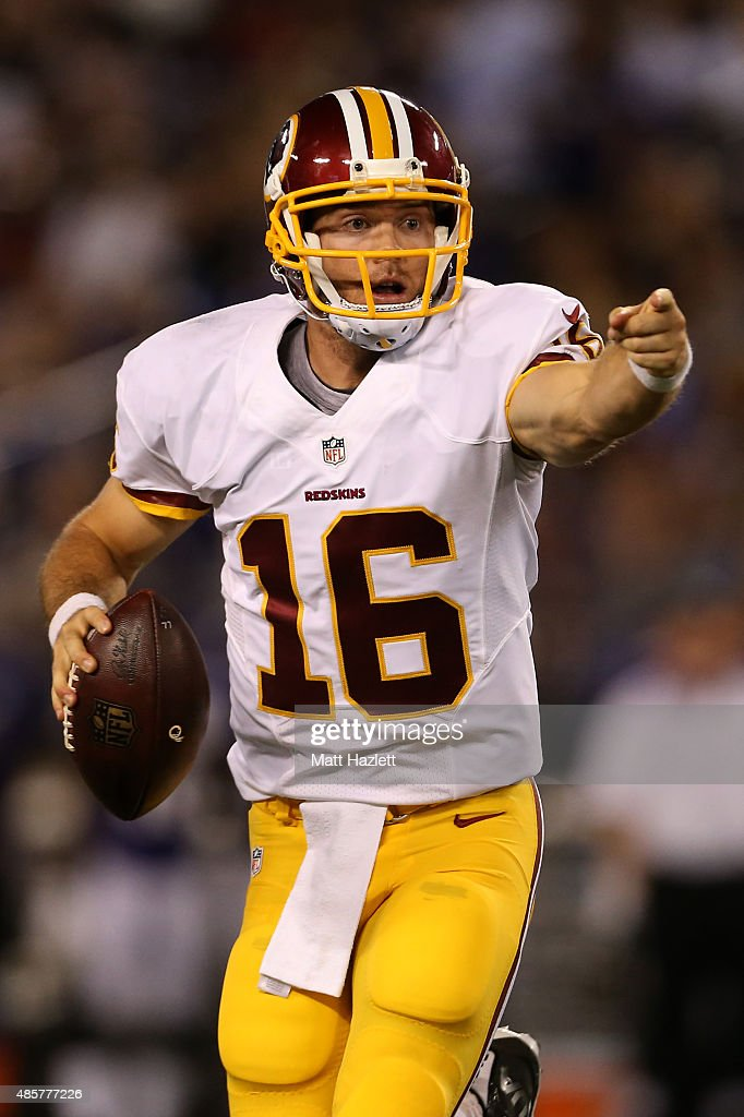 Quarterback Colt McCoy #16 of the Washington Redskins scrambles in the third quarter of a preseason game against the Baltimore Ravens at M&T Bank Stadium on August 29, 2015 in Baltimore, Maryland.