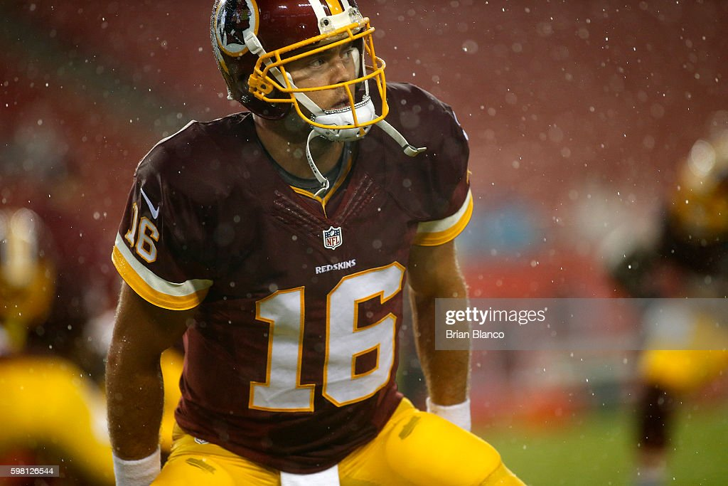 Quarterback Colt McCoy #16 of the Washington Redskins warms up before the start of an NFL game against the Tampa Bay Buccaneers on August 31, 2016 at Raymond James Stadium in Tampa, Florida.