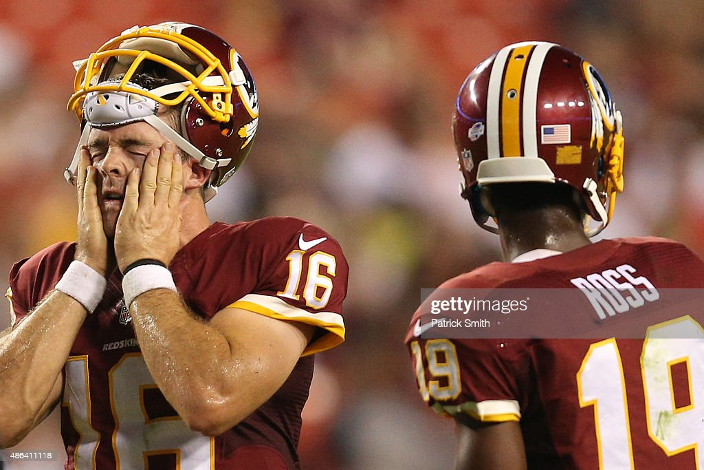 Quarterback Colt McCoy #16 of the Washington Redskins wipes his face during a stoppage in play against the Jacksonville Jaguars in the second half at FedExField on September 3, 2015 in Landover, Maryland.