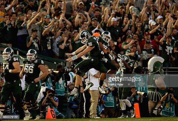 Quarterback Connor Cook and running back RJ Shelton of the Michigan State Spartans celebrate after a touchdown against the Stanford Cardinal during...