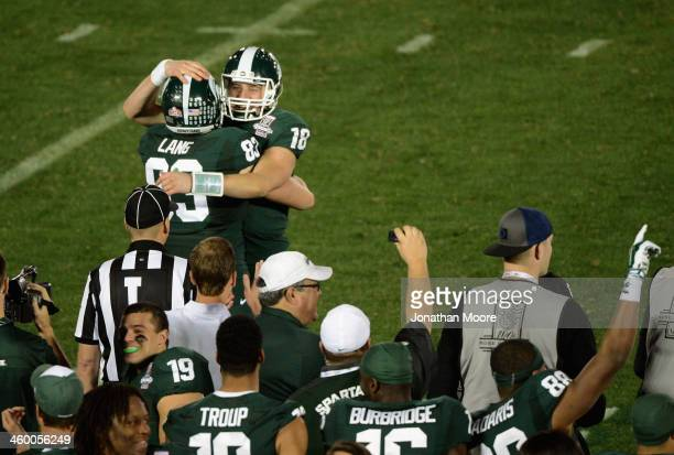 Quarterback Connor Cook and tight end Paul Lang of the Michigan State Spartans celebrate following their 24-20 win over the Stanford Cardinal in the...