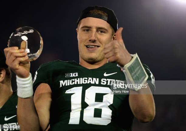 Quarterback Connor Cook of the Michigan State Spartans celebrates after receiving the offensive Rose Bowl Player of the Game Award following Michigan...