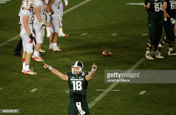 Quarterback Connor Cook of the Michigan State Spartans celebrates after defeating the Stanford Cardinal 2420 in the 100th Rose Bowl Game presented by...
