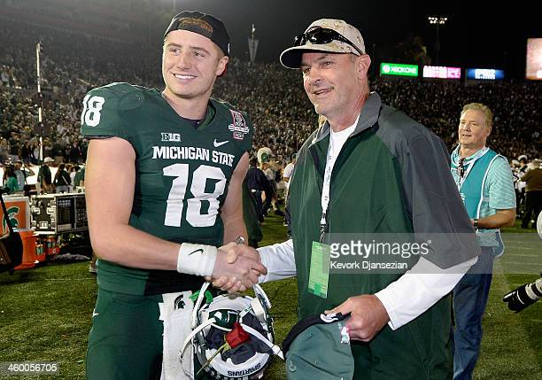 Quarterback Connor Cook of the Michigan State Spartans poses with the manager of the Arizona Diamondbacks Kirk Gibson after their 2420 win over the...