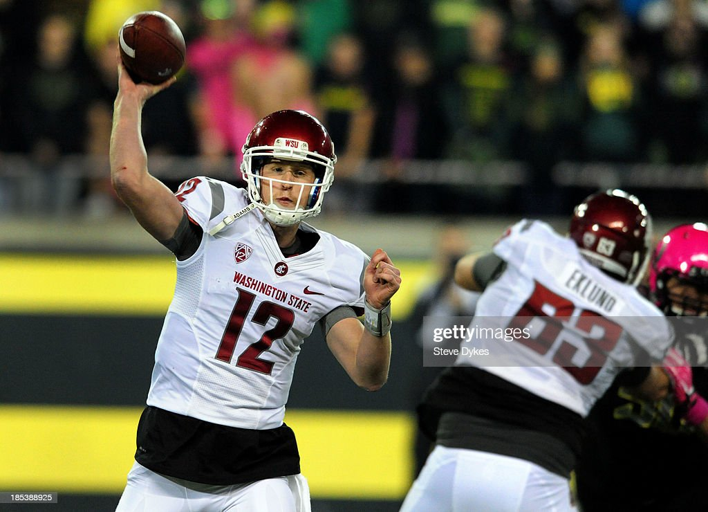 Quarterback Connor Halliday #12 of the Washington State Cougars passes the ball during the third quarter of the game against the Washington State Cougars at Autzen Stadium on October 19, 2013 in Eugene, Oregon. Oregon won the game 62-38.