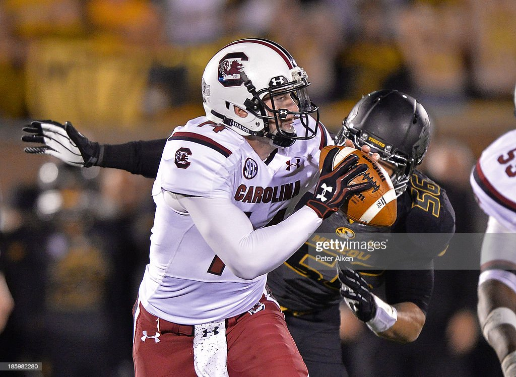 Quarterback Connor Shaw #14 of the South Carolina Gamecocks scrambles against pressure from defensive linemen Shane Ray #56 of the Missouri Tigers during the second half on October 26, 2013 at Faurot Field/Memorial Stadium in Columbia, Missouri. South Carolina defeated Missouri in double overtime 27-24.