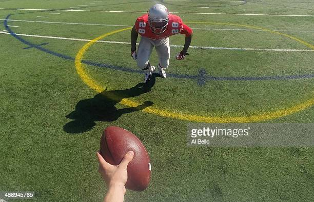 Quarterback Conor Bednarski of the Stony Brook Offense hands the ball to Running Back James Kenner during their Spring Football Game at Kenneth P...
