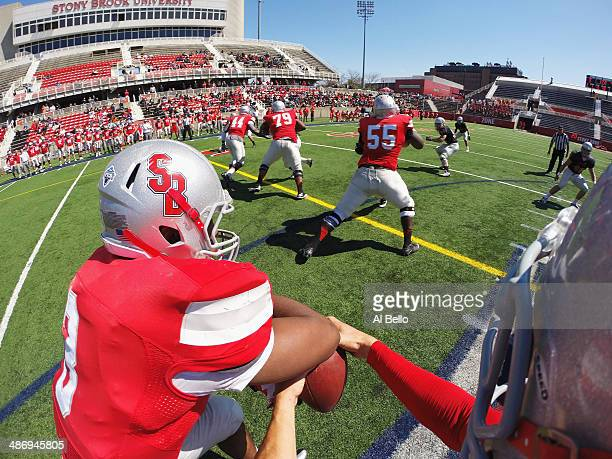 Quarterback Conor Bednarski of the Stony Brook Offense hands the ball to Running Back Tyler Fredericks during their Spring Football Game at Kenneth P...